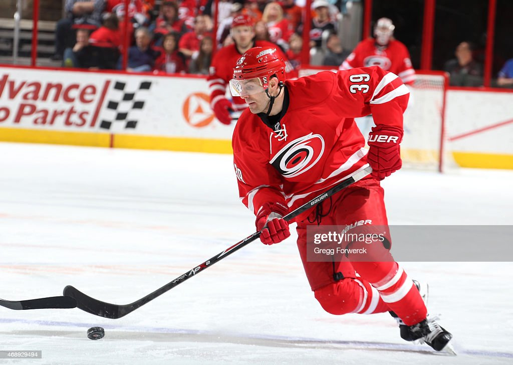Patrick Dwyer #39 of the Carolina Hurricanes attempts to gain control of a loose puck during their NHL game against the Philadelphia Flyers at PNC Arena on April 4, 2015 in Raleigh, North Carolina.