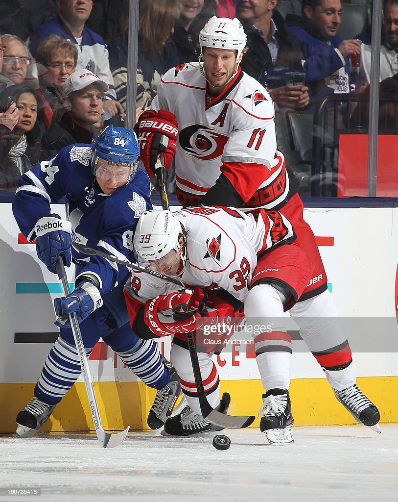 Patrick Dwyer #39 of the Carolina Hurricanes battles for puck control against <a gi-track='captionPersonalityLinkClicked' href=/galleries/search?phrase=Mikhail+Grabovski&family=editorial&specificpeople=2560547 ng-click='$event.stopPropagation()'>Mikhail Grabovski</a> #84 of the Toronto Maple Leafs in a game on February 4, 2013 at the Air Canada Centre in Toronto, Canada. The Hurricanes defeated the Leafs 4-1.