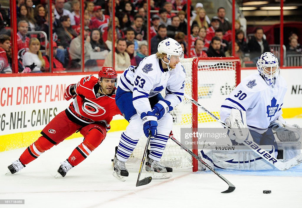 Patrick Dwyer #39 of the Carolina Hurricanes challenges Michael Kostka #53 of the Toronto Maple Leafs for the puck during play at PNC Arena on February 14, 2013 in Raleigh, North Carolina.