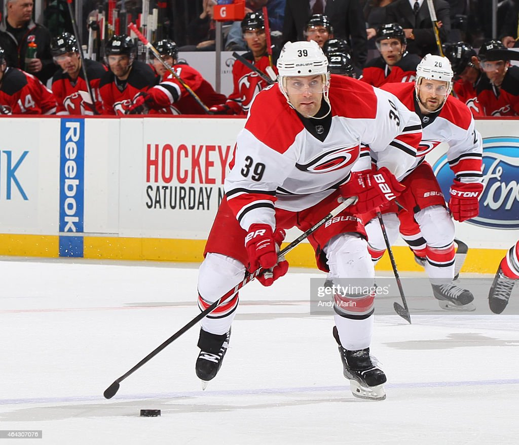 Patrick Dwyer #39 of the Carolina Hurricanes plays the puck during the game against the New Jersey Devils at the Prudential Center on February 21, 2015 in Newark, New Jersey.