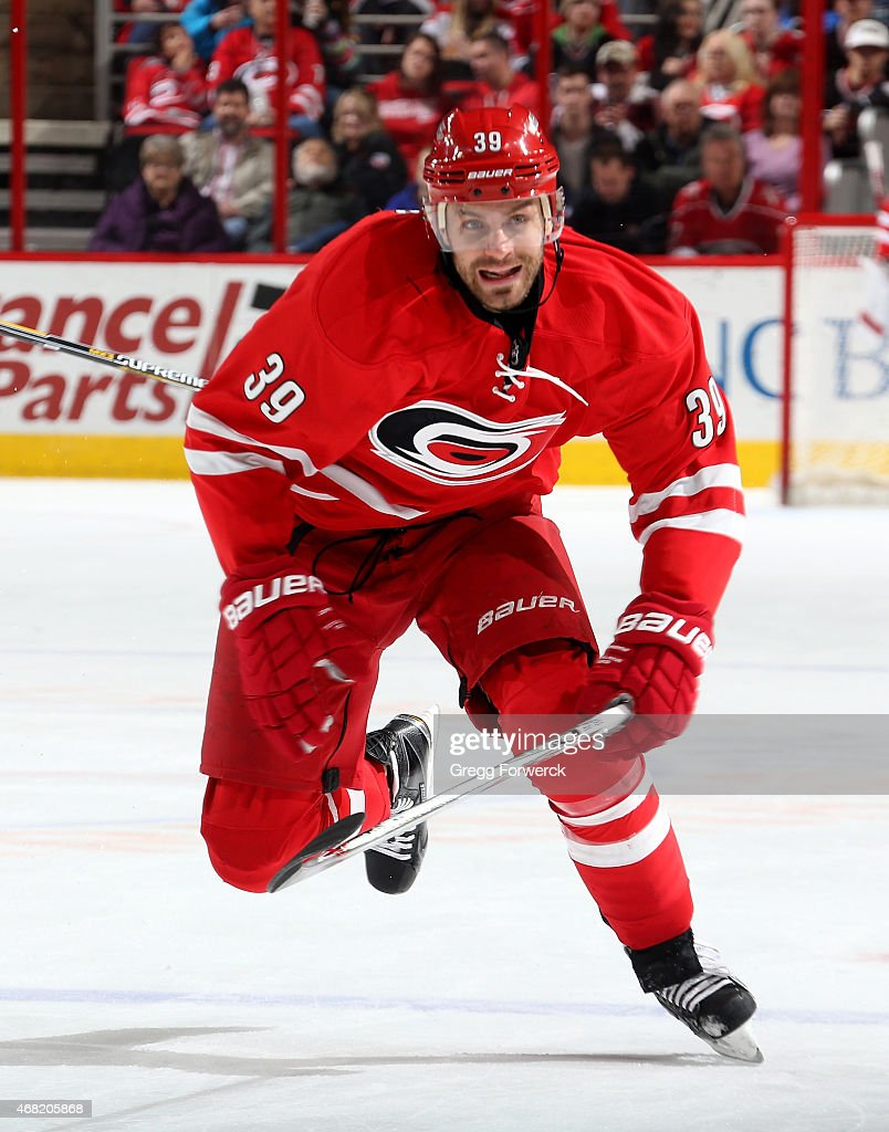 Patrick Dwyer #39 of the Carolina Hurricanes skates for position on the ice during their NHL game against the New Jersey Devils at PNC Arena on March 28, 2015 in Raleigh, North Carolina.