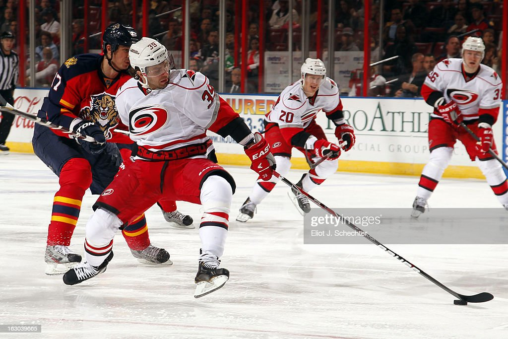 Patrick Dwyer #39 of the Carolina Hurricanes skates for possession against Filip Kuba #17 of the Florida Panthers at the BB&T Center on March 3, 2013 in Sunrise, Florida.