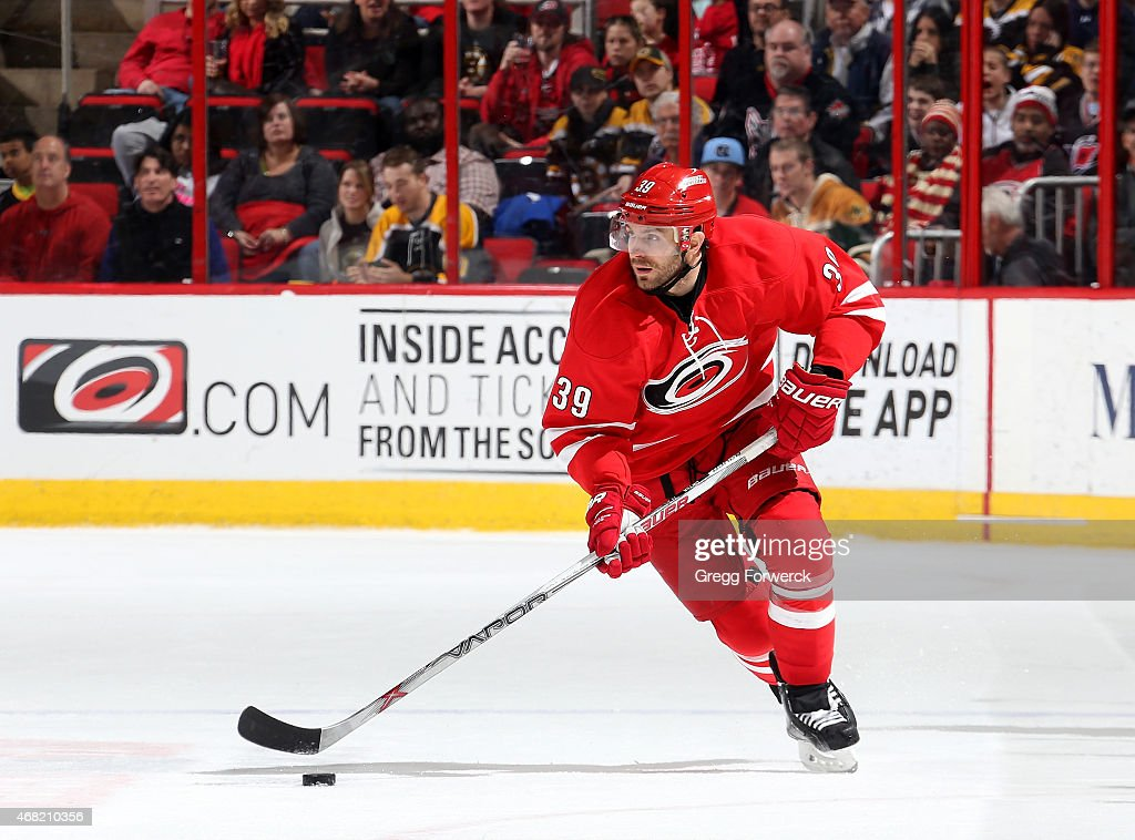 Patrick Dwyer #39 of the Carolina Hurricanes skates with the puck during their NHL game against the Boston Bruins at PNC Arena on March 29, 2015 in Raleigh, North Carolina.