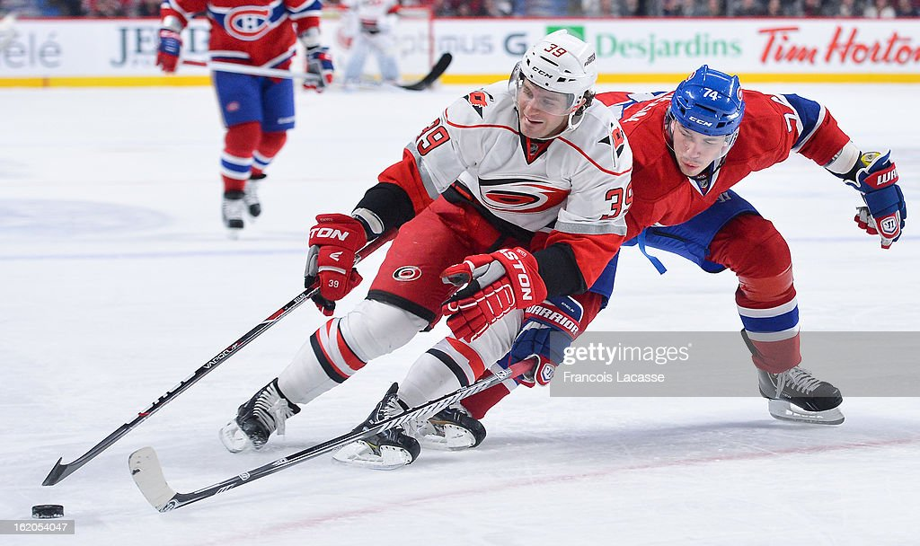 Patrick Dwyer #39 of the Carolina Hurricanes tries to drive past defenceman <a gi-track='captionPersonalityLinkClicked' href=/galleries/search?phrase=Alexei+Emelin&family=editorial&specificpeople=723573 ng-click='$event.stopPropagation()'>Alexei Emelin</a> #74 of the Montreal Canadiens during the NHL game on February 18, 2013 at the Bell Centre in Montreal, Quebec, Canada.