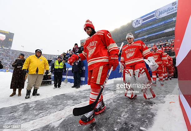 Patrick Eaves backup goaltender Petr Mrazek and their Detroit Red Wings teammates walk to the ice surface for warmup during the 2014 Bridgestone NHL...