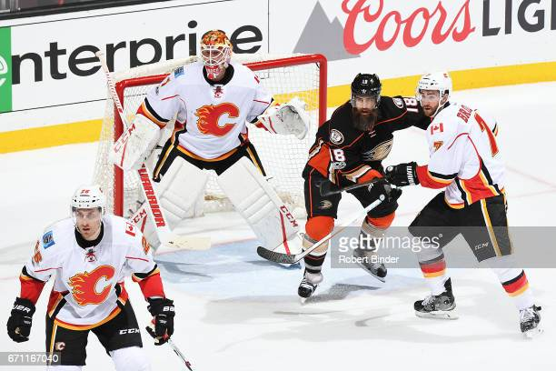 Patrick Eaves of the Anaheim Ducks battles against TJ Brodie Brian Elliott and Michael Stone of the Calgary Flames in Game One of the Western...