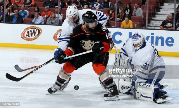 Patrick Eaves of the Anaheim Ducks battles for the puck against Alexey Marchenko and Curtis McElhinney of the Toronto Maple Leafs on March 3 2017 at...
