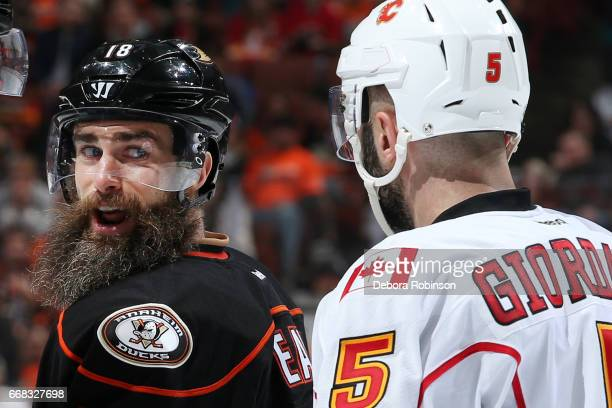 Patrick Eaves of the Anaheim Ducks chats with Mark Giordano of the Calgary Flames after a whistle in Game One of the Western Conference First Round...