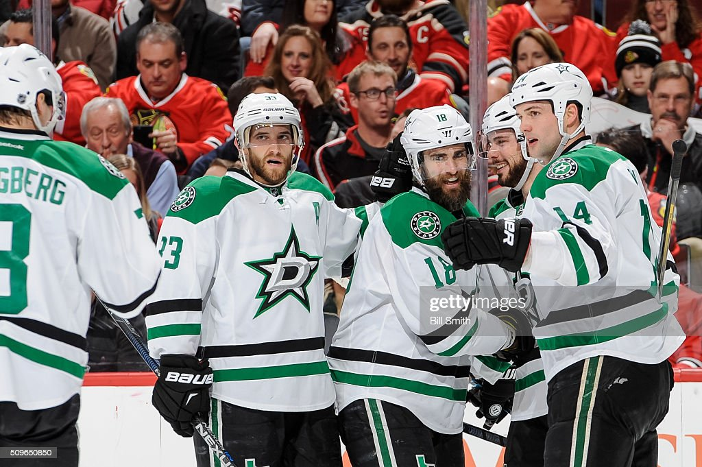 Patrick Eaves #18 of the Dallas Stars (middle) celebrates with Mattias Alex Goligoski #33 and Jamie Benn #14 after scoring his second goal against the Chicago Blackhawks in the first period of the NHL game at the United Center on February 11, 2016 in Chicago, Illinois.