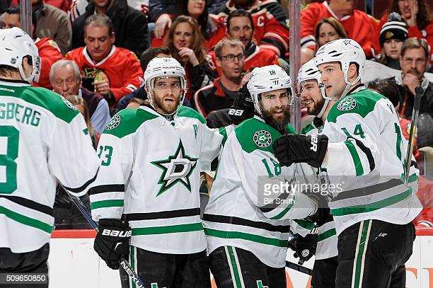 Patrick Eaves of the Dallas Stars celebrates with Mattias Alex Goligoski and Jamie Benn after scoring his second goal against the Chicago Blackhawks...