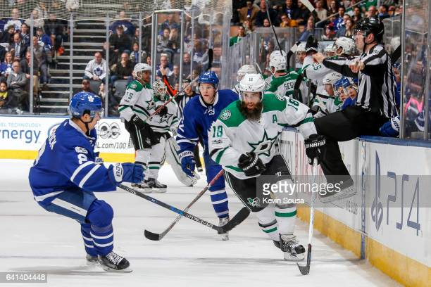 Patrick Eaves of the Dallas Stars skates with the puck pass Connor Carrick of the Toronto Maple Leafs during the third period at the Air Canada...