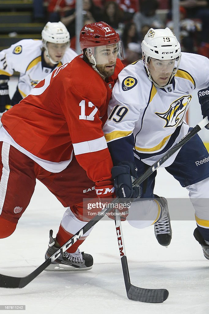 Patrick Eaves of the Detroit Red Wings battles for positioning with Bobby Butler of the Nashville Predators during an NHL game at Joe Louis Arena on...