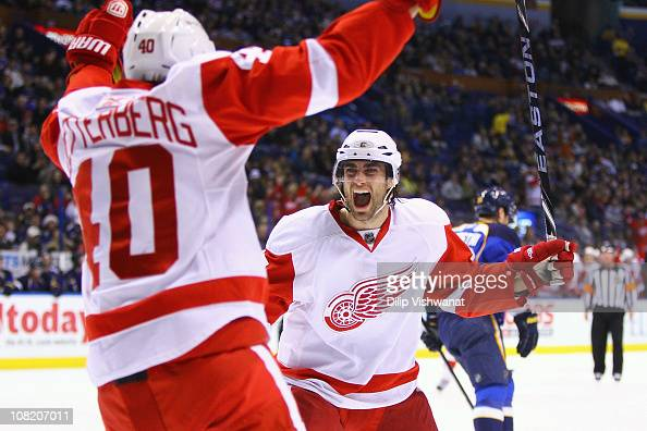 Patrick Eaves of the Detroit Red Wings celebrates his goal with his teammate Henrik Zetterberg against the St Louis Blues at the Scottrade Center on...