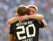 Patrick Ebert of Berlin jubilates with team mate Torun Tunay after scoring the first goal during the preseason friendly match between Hertha BSC...