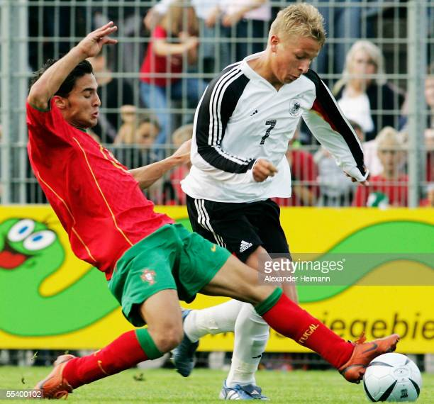 Patrick Ebert of Germany competes with Helder Barbosa of Portugal during the men's under 19 friendly match between Germany and Portugal on September...