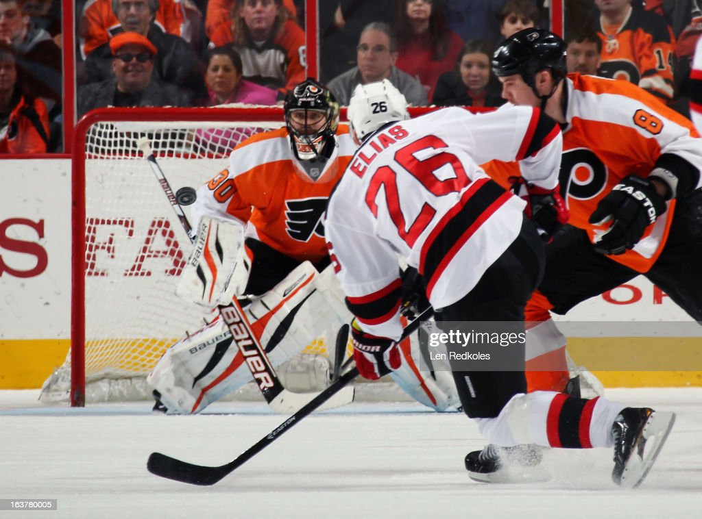 Patrick Elias #26 of the New Jersey Devils takes a shot against goaltender <a gi-track='captionPersonalityLinkClicked' href=/galleries/search?phrase=Ilya+Bryzgalov&family=editorial&specificpeople=2285430 ng-click='$event.stopPropagation()'>Ilya Bryzgalov</a> #30 of the Philadelphia Flyers on March 15, 2013 at the Wells Fargo Center in Philadelphia, Pennsylvania.