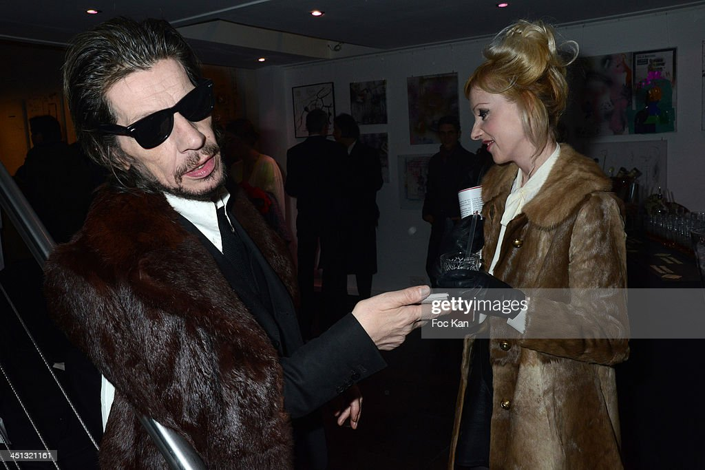 Patrick Eudeline and a guest attend the 'Flags From The Old Regime' : Pete Doherty and Alize Meurisse Paintings Exhibition Preview At Espace Djam on November 21, 2013 in Paris, France.