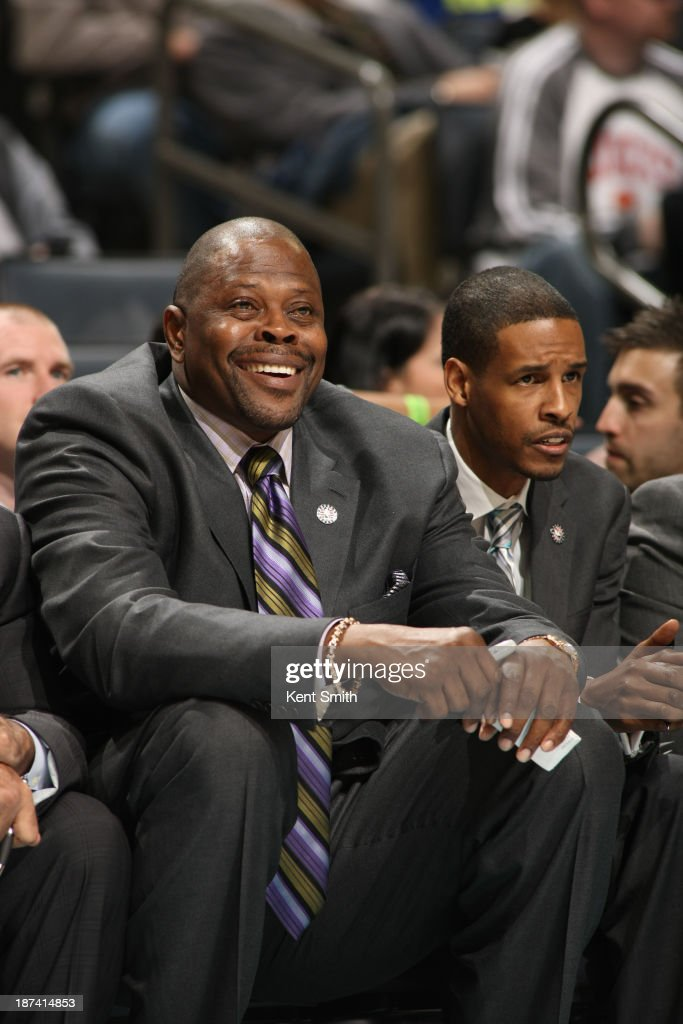 Patrick Ewing, acting head coach for the Charlotte Bobcats smiles during the game against the New York Knicks at the Time Warner Cable Arena on November 8, 2013 in Charlotte, North Carolina.