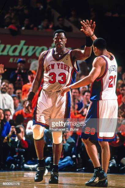 Patrick Ewing and Allan Houston of the New York Knicks high five during Game One of the NBA Playoffs Eastern Conference First Round against the...