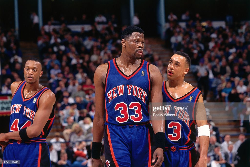 Patrick Ewing and John Starks of the New York Knicks talk against the Sacramento Kings on February 20 1997 at Arco Arena in Sacramento California...