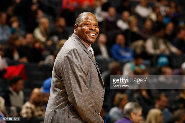 Patrick Ewing assistant coach of the Charlotte Hornets smiles during the game against the New York Knicks at the Time Warner Cable Arena on January...