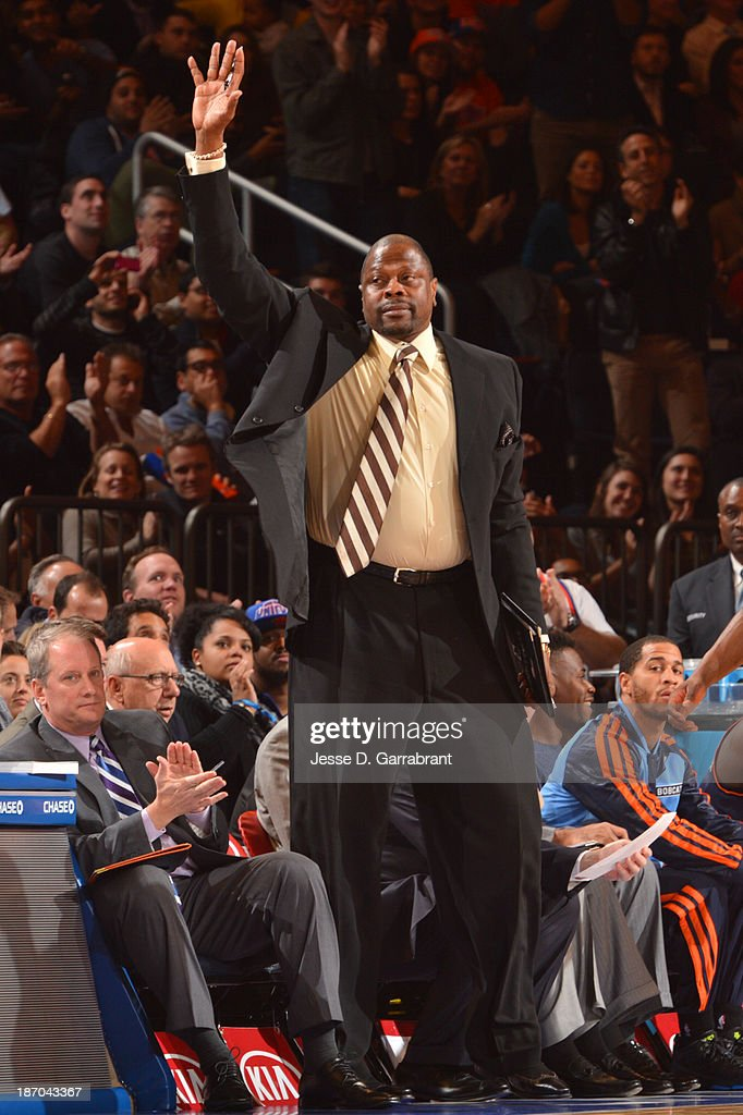 Patrick Ewing, former Knicks Player and current assistant coach for the Charlotte Bobcats, stands and acknowledges the crowd as the Bobcats play against he New York Knicks during the game on November 5, 2013 at Madison Square Garden in New York City, New York.