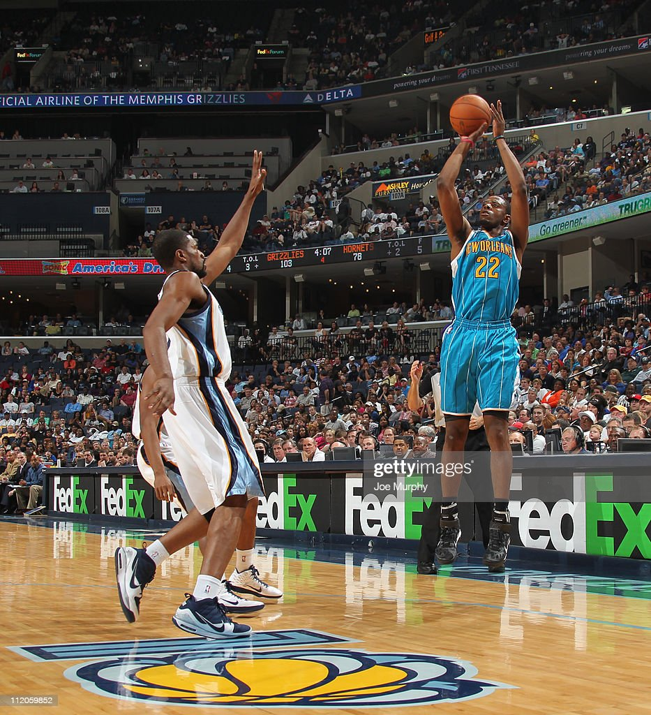 Patrick Ewing Jr #22 of the New Orleans Hornets shoots against Leon Powe of the Memphis Grizzlies during the game on April 10 2011 at FedExForum in...