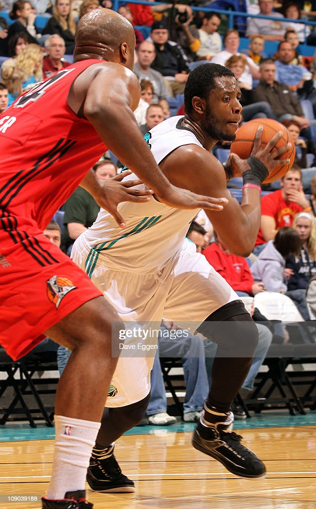 <a gi-track='captionPersonalityLinkClicked' href=/galleries/search?phrase=Patrick+Ewing+Jr.&family=editorial&specificpeople=2551108 ng-click='$event.stopPropagation()'>Patrick Ewing Jr.</a> #22 of the Sioux Falls Skyforce drives against <a gi-track='captionPersonalityLinkClicked' href=/galleries/search?phrase=Antoine+Walker&family=editorial&specificpeople=201601 ng-click='$event.stopPropagation()'>Antoine Walker</a> #24 of the Idaho Stampede in the second half of their game February 12, 2011 at the Sioux Falls Arena in Sioux Falls, South Dakota.