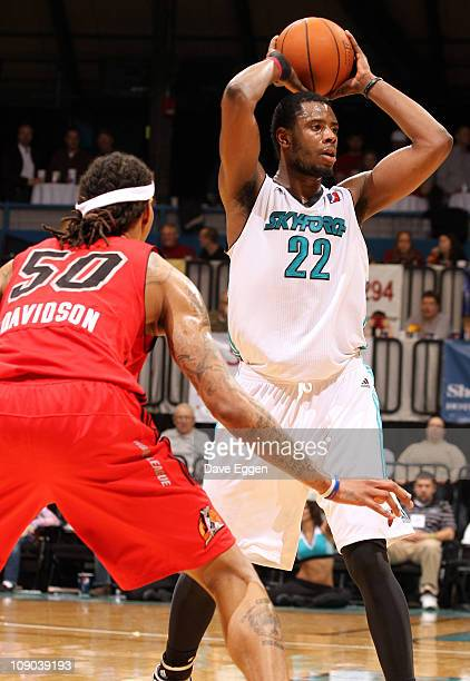Patrick Ewing Jr #22 of the Sioux Falls Skyforce looks to pass the ball to a teammate while being guarded by Jermareo Davidson of the Idaho Stampede...