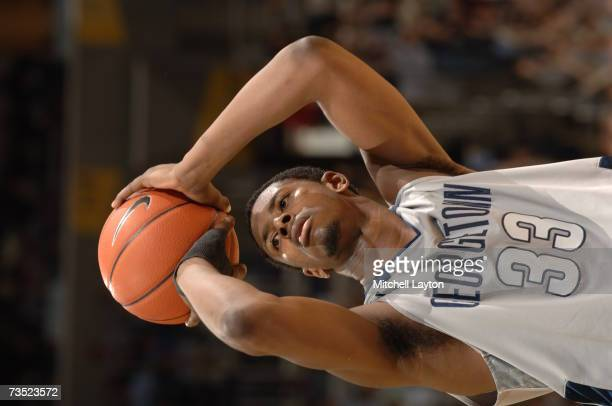 Patrick Ewing Jr #33 of the Georgetown Hoyas shoots a foul shot during a college basketball game against the Connecticut Huskies at Verizon Center on...