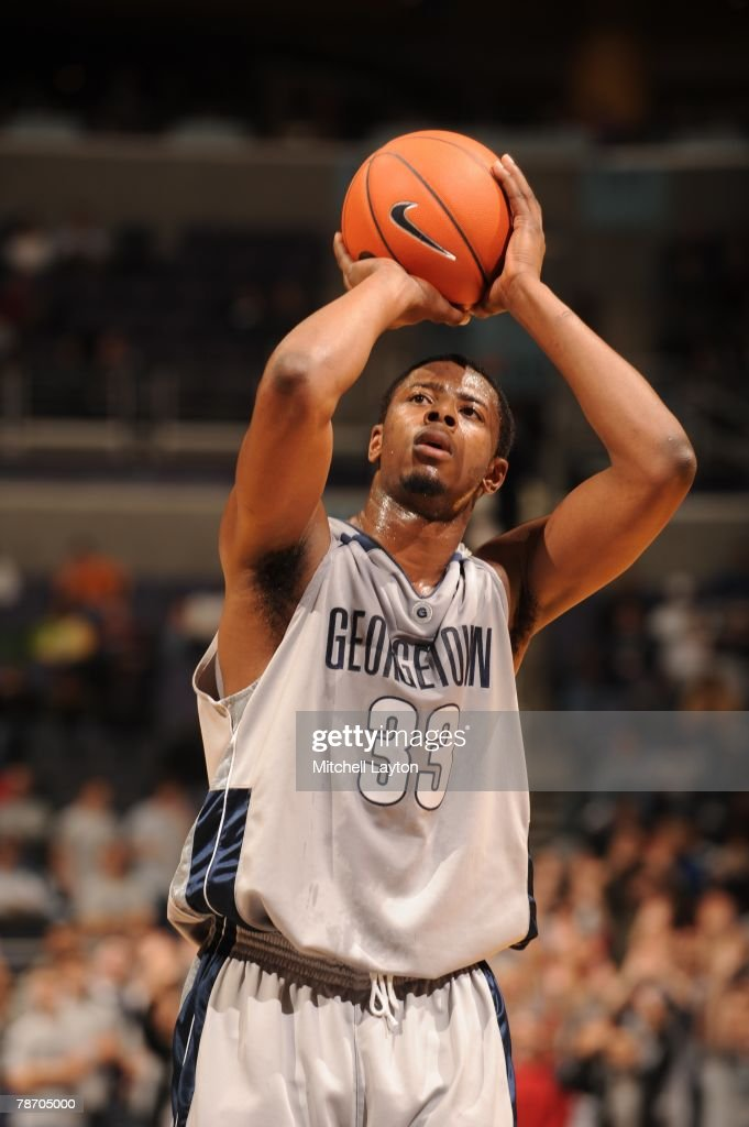 <a gi-track='captionPersonalityLinkClicked' href=/galleries/search?phrase=Patrick+Ewing+Jr.&family=editorial&specificpeople=2551108 ng-click='$event.stopPropagation()'>Patrick Ewing Jr.</a> #33 of the Georgetown Hoyas takes a foul shot during a basketball game against the Fordham Rams at Verizon Center on December 31, 2007 in Washington, D.C.