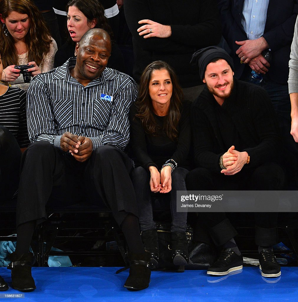 Patrick Ewing, Kelly Monaco and Valentin Chmerkovskiy attend the Chicago Bulls vs New York Knicks game at Madison Square Garden on December 21, 2012 in New York City.