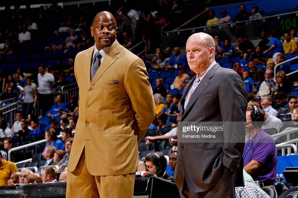 Patrick Ewing, left, and Steve Clifford, assistant coaches of the Orlando Magic, watch their team warm up before playing the Indiana Pacers in Game Four of the Eastern Conference Quarterfinals during the 2012 NBA Playoffs on May 5, 2012 at Amway Center in Orlando, Florida.
