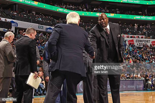 Patrick Ewing of the Charlotte Hornets shakes hands before the game against the New York Knicks on November 26 2016 at Spectrum Center in Charlotte...