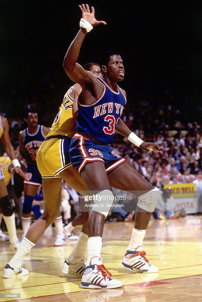 Patrick Ewing of the New York Knicks battles for position against Kareem Abdul Jabbar of the Los Angeles Lakers during an NBA game at The Forum in...