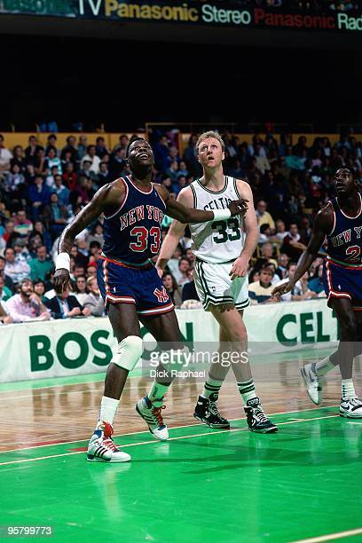 Patrick Ewing of the New York Knicks boxes out against Larry Bird of the Boston Celtics during a game played in 1988 at the Boston Garden in Boston...