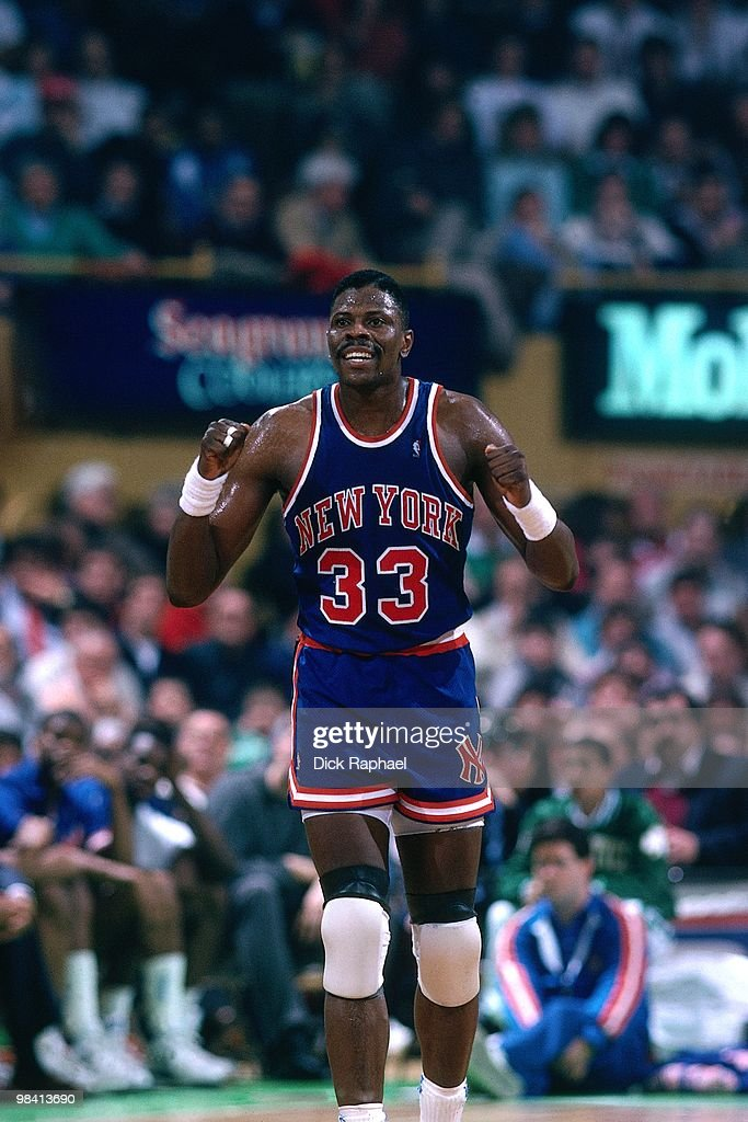 Patrick Ewing of the New York Knicks celebrates against the Boston Celtics during a game played in 1989 at the Boston Garden in Boston Massachusetts...