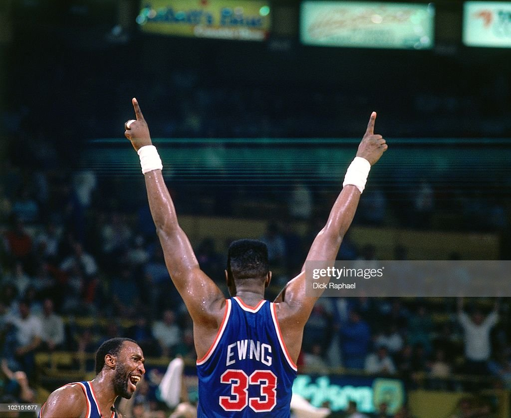Patrick Ewing #33 of the New York Knicks points his fingers in the sky against the Boston Celtics during a game played in 1990 at the Boston Garden in Boston, Massachusetts.
