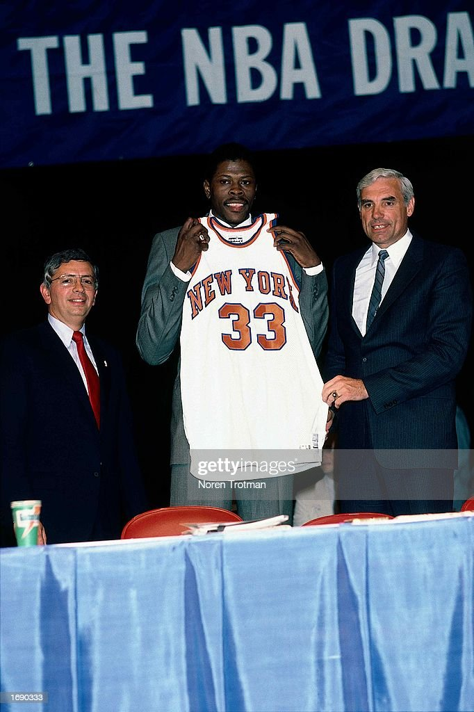 Patrick Ewing of the New York Knicks poses for a portrait with the Knicks General Manager Dave DeBusschere and NBA Commissioner David Stern during...