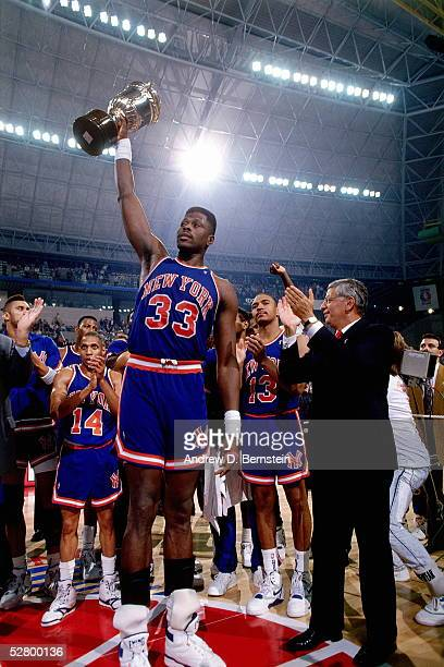 Patrick Ewing of the New York Knicks receives the MVP trophy of the 1990 McDonald's Open circa 1990 in Barcelona Spain NOTE TO USER User expressly...