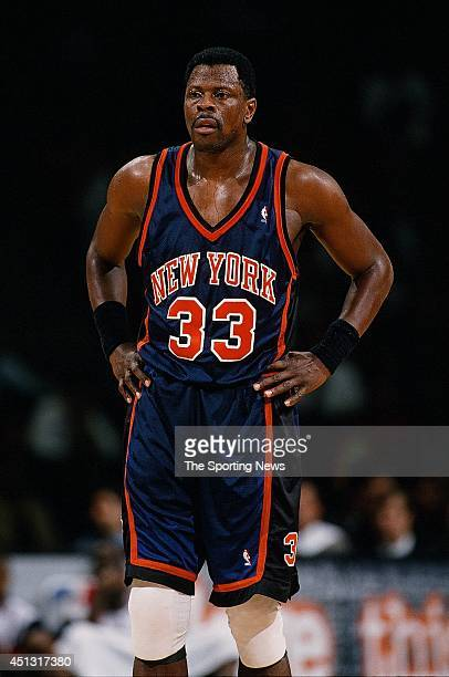 Patrick Ewing of the New York Knicks stands on the court during the game against the Houston Rockets on November 18 1997 at the Compaq Center in...