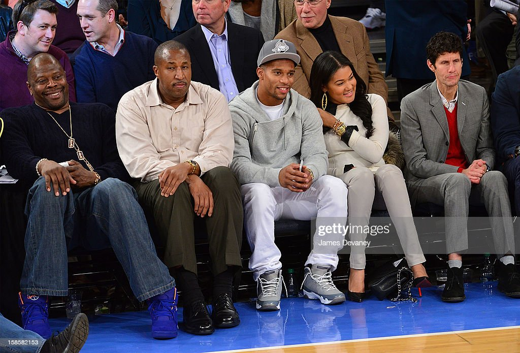 Patrick Ewing, Victor Cruz (C) and Mike D (R) attend the Brooklyn Nets vs New York Knicks game at Madison Square Garden on December 19, 2012 in New York City.