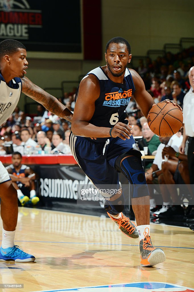 Patrick EwingJr #6 of the Charlotte Bobcats drives against the Dallas Mavericks during NBA Summer League on July 14 2013 at the Cox Pavilion in Las...