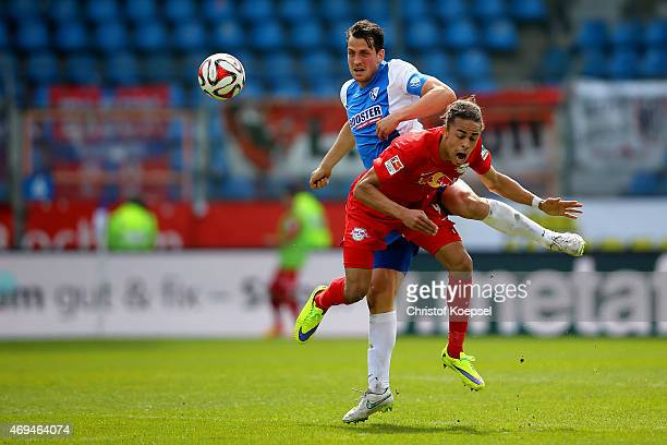 Patrick Fabian of Bochum challenges Yussuf Poulsen of Leipzig during the Second Bundesliga match between VfL Bochum and RB Leipzig at Rewirpower...