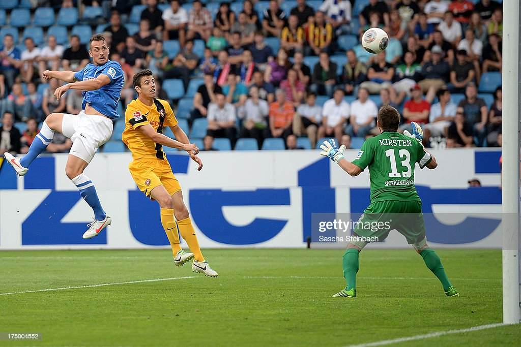 Patrick Fabian of Bochum jumps for a header and scores the opening goal during the Second Bundesliga match between VfL Bochum and Dynamo Dresden at...