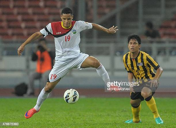 Patrick Fabiano of East Timor vies the ball against Mohamad Fadhli of Malaysia during their 2018 World Cup qualifying Group A football match in Kuala...