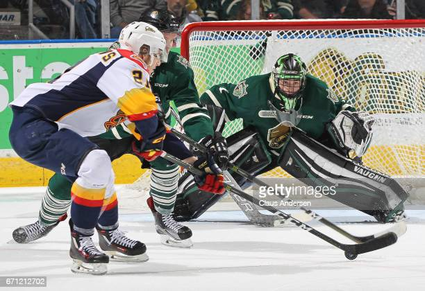 Patrick Fellows of the Erie Otters looks to get a shot on Tyler Parsons of the London Knights in Game Six of the OHL Western Conference SemiFinal on...