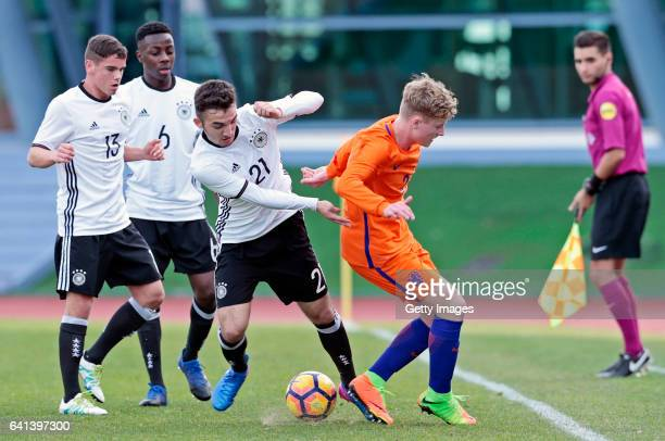 Patrick Finger MatondoMerveille Papela and Erkan Eyibil of Germany U16 challenges Vincent Schippers of Netherlands U16 during the UEFA Development...