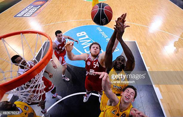 Patrick Flomo of Ludwigsburg and Michael Stockton of Ludwigsburg are challenged by John Bryant of Muenchen during the Beko BBL Playoffs semifinal...