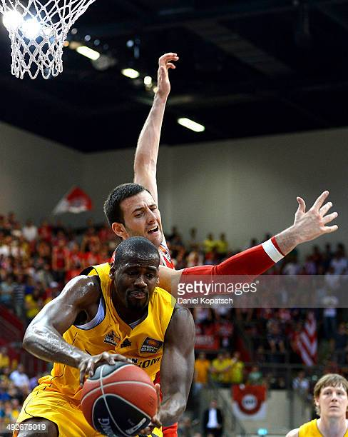 Patrick Flomo of Ludwigsburg is challenged by Boris Savovic of Muenchen during the Beko BBL Playoffs semifinal match between MHP RIESEN Ludwigsburg...